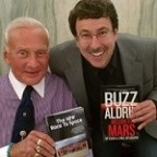 Eric Knight and Buzz Aldrin exchange signed copies of their books